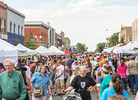 Image of crowded downtown Laramie as people visit the Farmer's Market.