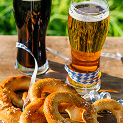 Image of beer in glasses a pretzels during Laramie Brewfest