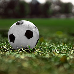 Image of soccer ball on field, ready for the game
